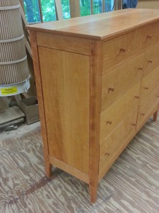 Post and panel 9 drawer cherry dresser