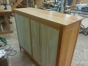 ship lapped pine back on handmade cherry dresser